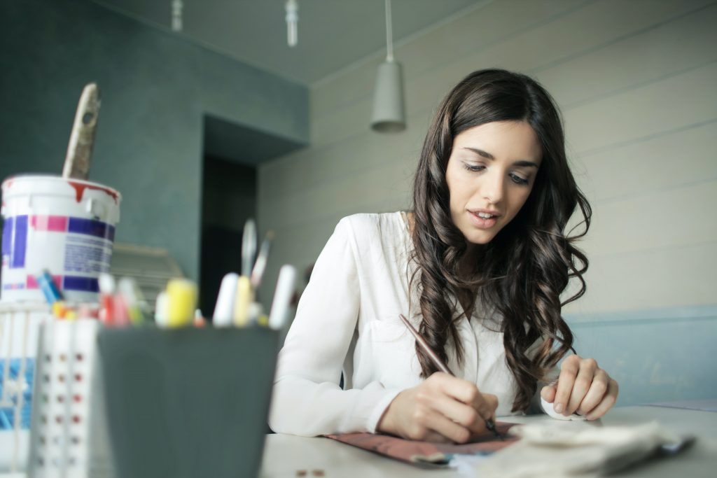 ::Downloads:woman-sitting-while-holding-pen-920377.jpg